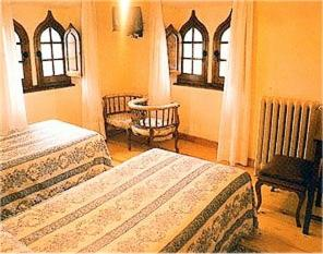 A bed or beds in a room at Casa España