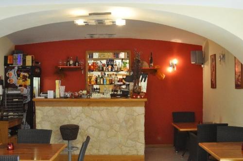 The lounge or bar area at Penzion Stara Fara