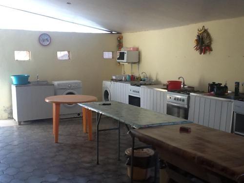 "A kitchen or kitchenette at Гостевой дом ""Светлана"""