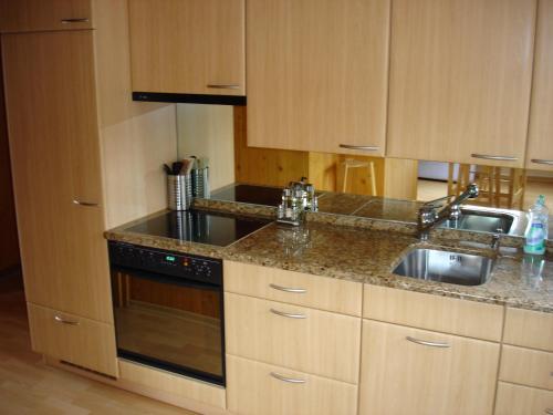 Küche/Küchenzeile in der Unterkunft Chalet Sunneschyn