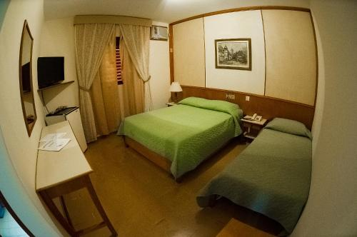 A bed or beds in a room at Hotel Thermas Lagoa Santa