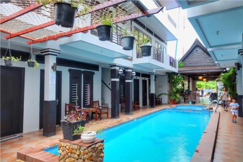 The swimming pool at or near VIBOLA Guesthouse