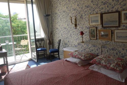 Un ou plusieurs lits dans un hébergement de l'établissement Chambres d'Hôtes Chez Bérénice
