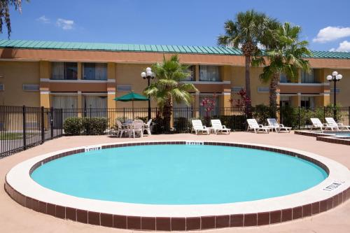 The swimming pool at or near Baymont by Wyndham Florida Mall