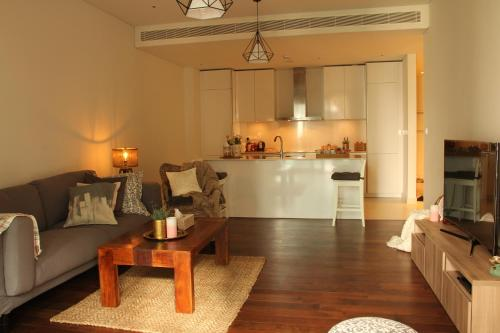 A kitchen or kitchenette at Serenity Apartment - City Walk