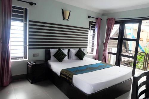 A bed or beds in a room at VIBOLA Guesthouse