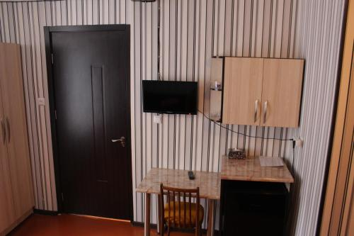 A television and/or entertainment center at Guest House Anano