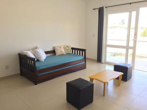 A seating area at Varandas da Praia Apartamentos
