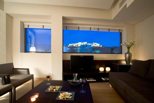 A television and/or entertainment centre at O&B Athens Boutique Hotel
