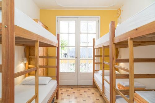 A bunk bed or bunk beds in a room at Solar63 Hostel Porto Alegre