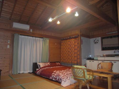 A kitchen or kitchenette at Minnsyuku Yakushimaya