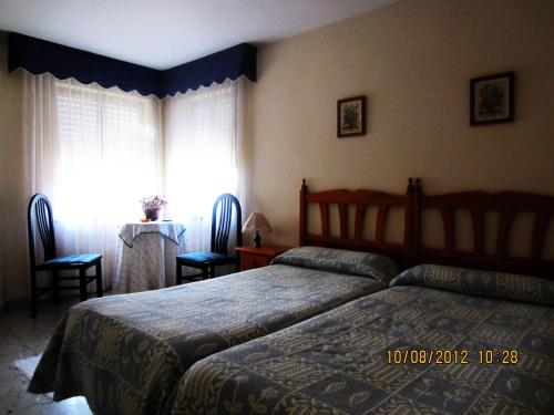 A bed or beds in a room at Hotel Toscana