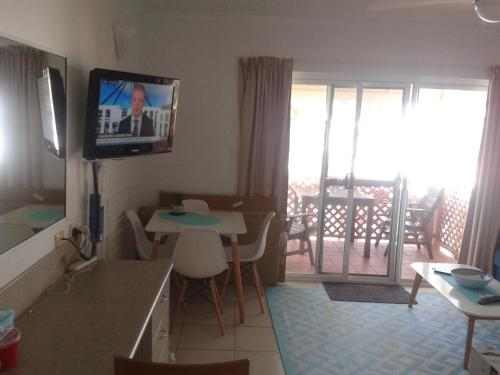 A television and/or entertainment center at Apartment in Dolphin Heads Resort