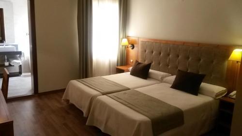 Cama o camas de una habitación en Hotel Sierra Las Villas