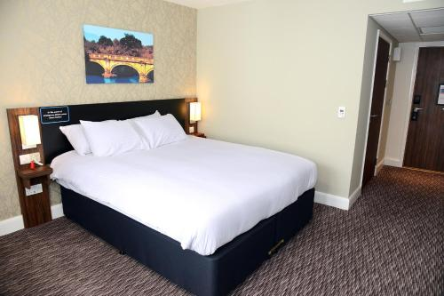 A bed or beds in a room at Blue Jay, Derby by Marston's Inns