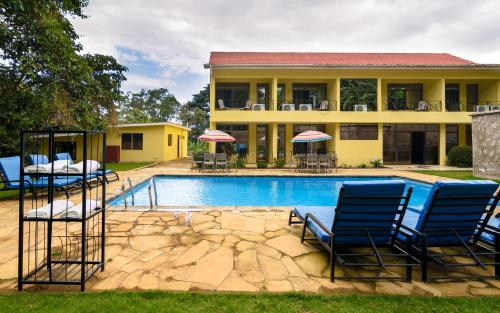 The swimming pool at or near Mvuli Hotels Arusha