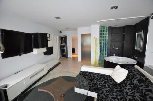 A television and/or entertainment center at Loft Suitte Costa Noja