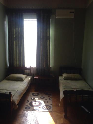 A bed or beds in a room at Gelati Guest House