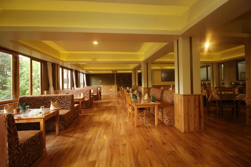 A restaurant or other place to eat at Hotel Tarayana Grand
