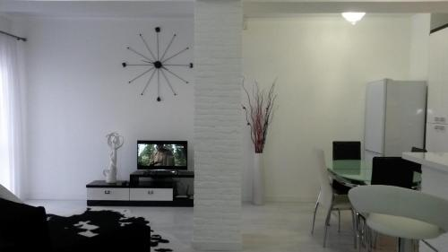A television and/or entertainment center at Apart Deluxe