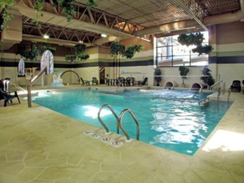 The swimming pool at or near Ramada by Wyndham Waupaca