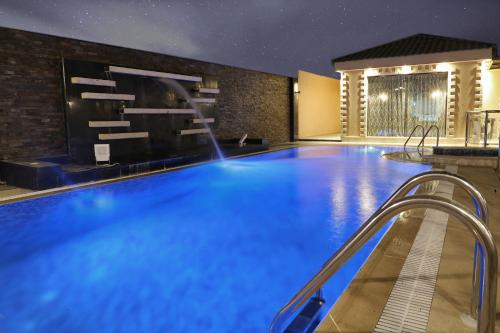 The swimming pool at or near Alasdaf Chalets