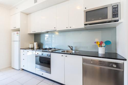 A kitchen or kitchenette at Astra Apartments Sydney