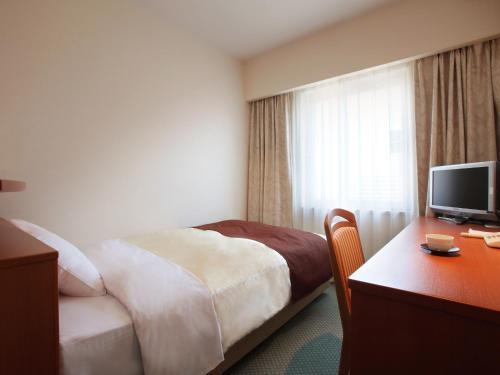 盛岡珍珠城市飯店房間的床