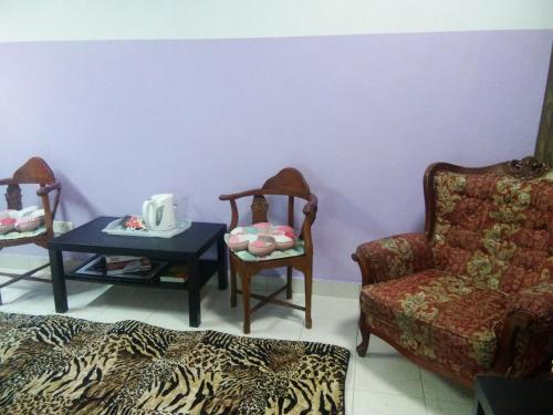 A seating area at Comfort Homestay