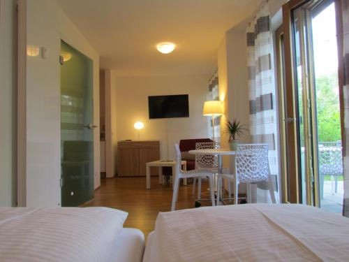 A bed or beds in a room at AMENITY-Garden-Apartments