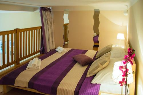 Postel nebo postele na pokoji v ubytování Apartment Jindrisska 25