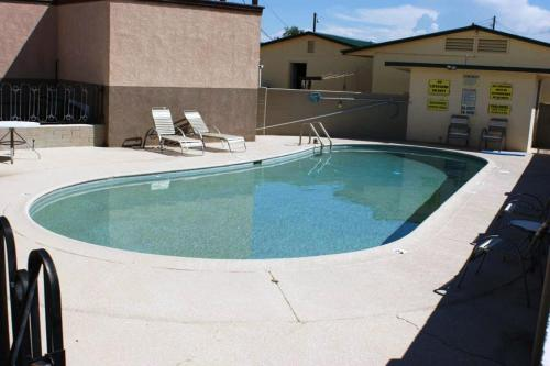 The swimming pool at or near HWY Express Inn and Suites