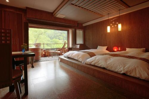 A bed or beds in a room at Kansyokan