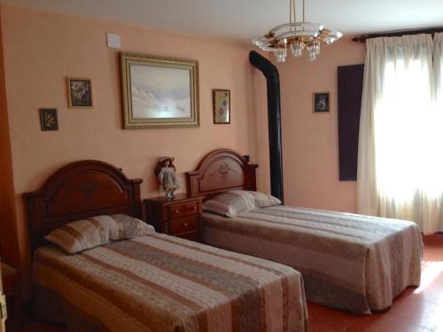 Cama o camas de una habitación en Encanto de Aragón