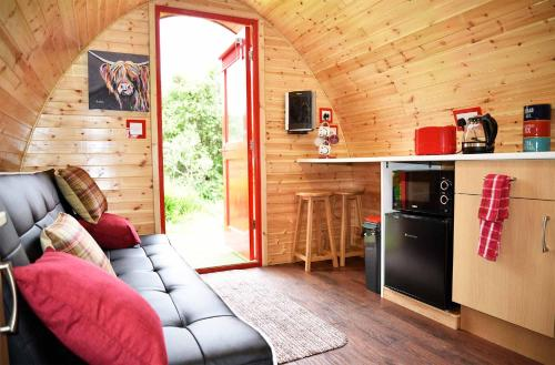 A seating area at Dunvegan Camping Pods