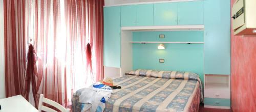 Postel nebo postele na pokoji v ubytování Hotel Fortuna