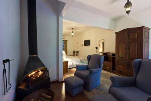 Uma área de estar em Hotel Fazenda 3 Pinheiros