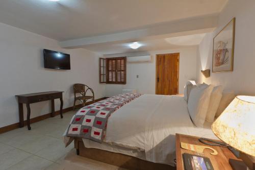Cama ou camas em um quarto em Hotel Fazenda 3 Pinheiros