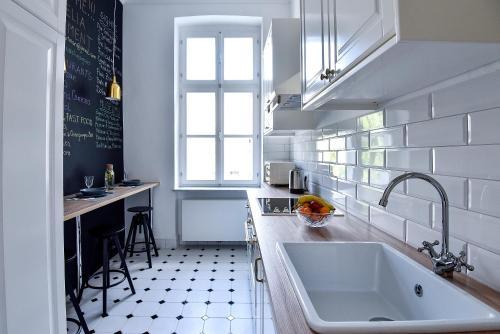 Кухня или мини-кухня в Marulic Square Garden