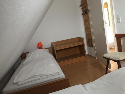 Ein Bett oder Betten in einem Zimmer der Unterkunft Hotel Stadt Mainz