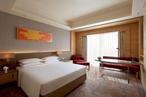 A bed or beds in a room at Hyatt Regency Chandigarh