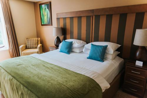 A bed or beds in a room at Spa Hotel at Ribby Hall Village
