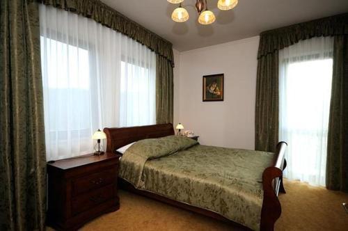 Łóżko lub łóżka w pokoju w obiekcie Hotel Salamandra