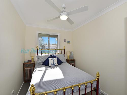 A bed or beds in a room at The Nautical House