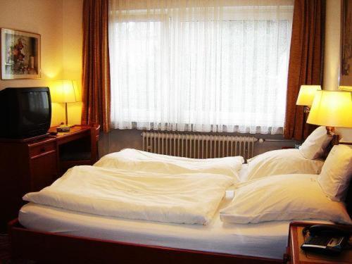 Кровать или кровати в номере Hotel - Restaurant Reher Hof
