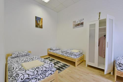 """A bed or beds in a room at Laisves Avenue Hostel """"Easy Kaunas"""""""