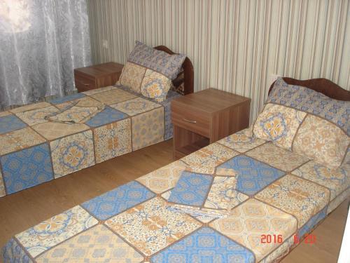 Кровать или кровати в номере Guest house Dlya Druzey