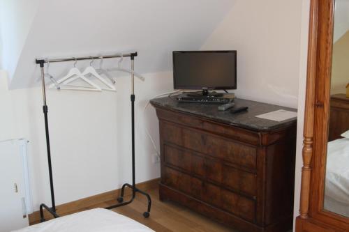Télévision ou salle de divertissement dans l'établissement Le Kiosque Amiens chambres d'hôtes