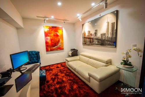 A seating area at Moon Luxury Apartments