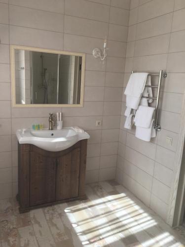 Ванная комната в Коттедж Агой